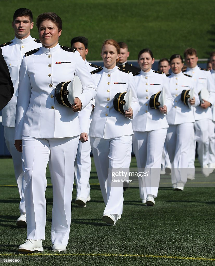U.S. Naval Academy Midshipmen 1st Class walk to their seats during graduation ceremonies at the U.S. Naval Academy May 27, 2016 in Annapolis, Maryland. This is the first year that female Midshipmen will be wearing the same uniform as the males. U.S. Secretary of Defense Ashton Carter is this year's commencement speaker.