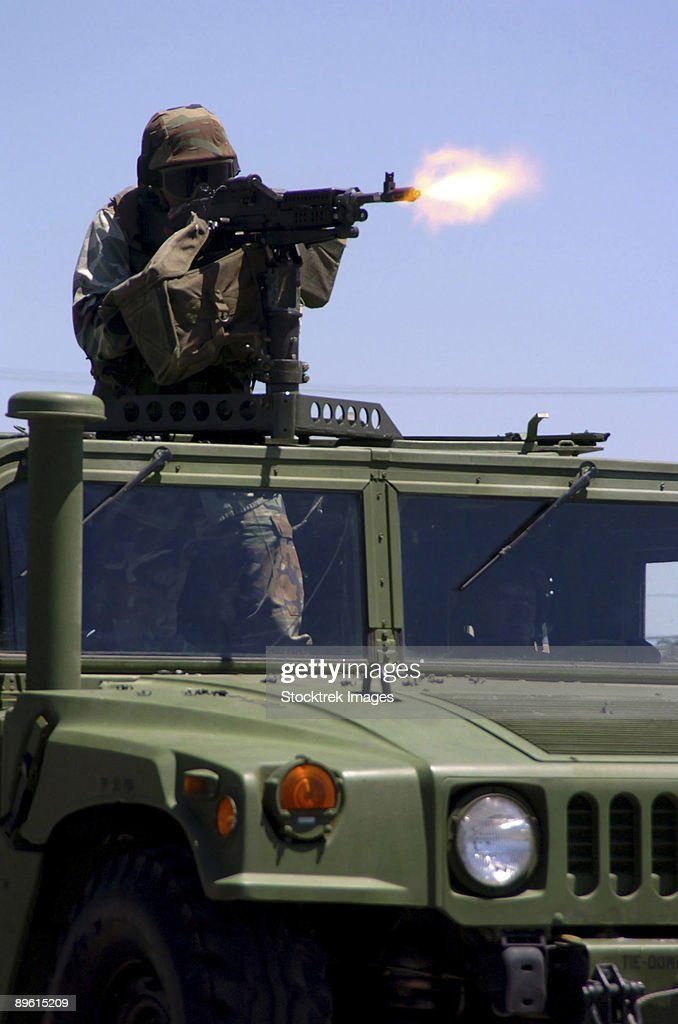 Naval Base Ventura County, California, July 17, 2004 - Engineering Aide shoots a M-240B machine gun as a fire power demonstration at the opening ceremony for Seabee Days.