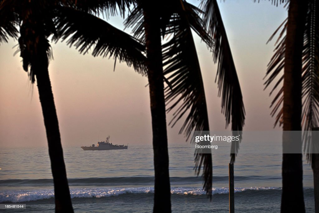 A naval boat patrols off the coast near the Windsor Barra Hotel in Rio de Janeiro, Brazil, on Monday, Oct. 21, 2013. Soldiers, army vehicles, helicopters and navy ships are guarding a Rio de Janeiro hotel where companies including China National Petroleum Corp., Royal Dutch Shell Plc and Total SA are expected to vie for one of the worlds two largest offshore fields at 3 p.m. local time, as oil workers protest the Dado Galdieri/Bloomberg via Getty Images