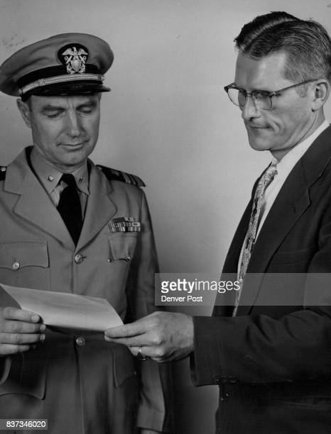 A naval citation praising The Denver Post for helping develop 'excellent relations between the navy and the people of Denver is presented by Lt Cmdr...