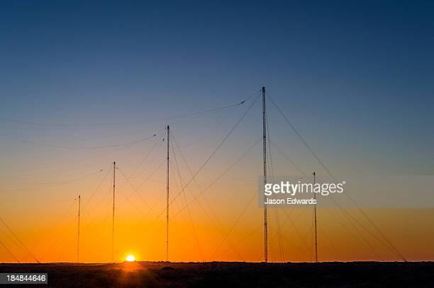 Radio relay station antennas communicate between ships and submarines.