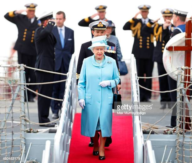 Naval Officers salute Queen Elizabeth II Duke of Lancaster as she disembarks HMS Lancaster following a visit to the ship at Portsmouth Naval Base on...