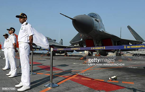Naval personnel stand to attention on Indias largest naval ship the INS Vikramaditya as she anchors in the Sri Lankan capital Colombo on January 21...