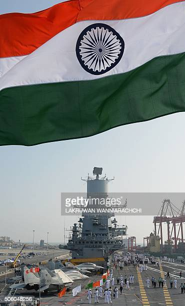 Naval personnel walk along Indias largest naval ship the INS Vikramaditya as she anchors in the Sri Lankan capital Colombo on January 21 as she sails...