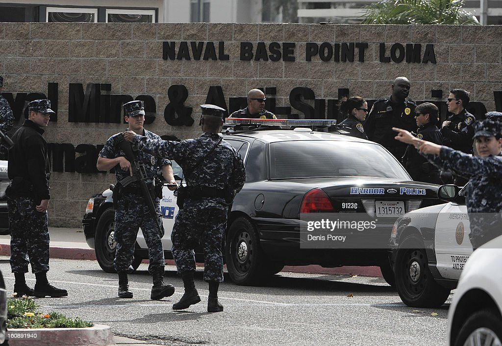 Naval security personnel lock down Naval Base Point Loma as police search for suspect, former LAPD officer Christopher Jordan Dorner, February 7, 2013 in San Diego, California. A manhunt is underway for Dorner, who is suspected of shooting at police officers in the Southern California area.