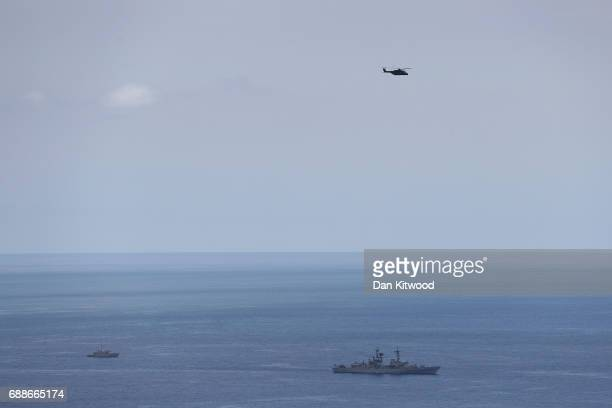 Naval ships providing security for the G7 meeting off the coast by the San Domenico Palace Hotel on May 26 2017 in Taormina Italy US President Donald...