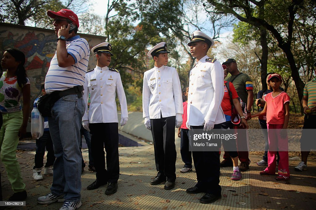 Naval students wait in line to view the body of deceased Venezuelan President Hugo Chavez outside the Military Academy on March 9, 2013 in Caracas, Venezuela. Venezuelans continue to wait in line for hours to pay their last respects to Chavez on the day after his funeral. Venezuela's elections commission has set April 14 as the date for voting to replace the late Chavez.