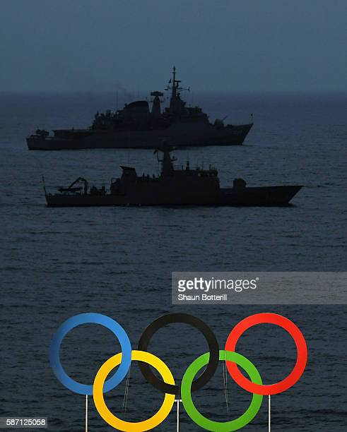 Naval vessels are seen behind the Olympic Rings on Day 2 of the Rio 2016 Olympic Games at the Beach Volleyball Arena on August 7 2016 in Rio de...