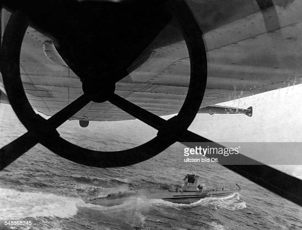 2WW Naval war Atlantic/ North Sea A german submarine at sea seen from a FW 200 long range sea reconnaissance plane 1942 Photographer Willi Ruge...