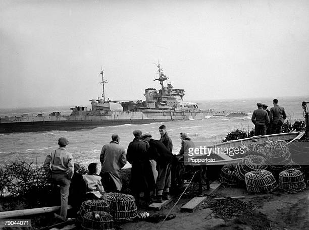 April 1947 The British capital ship 'HMS Warspite' which has run aground off Prussia Cove Cornwall having broke free from being towed to Faslane for...