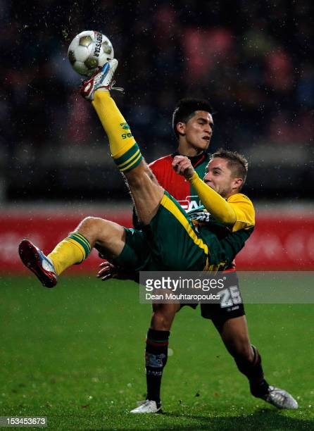 Navarone Foor of NEC defends against Aaron Meijers of Den Haag during the Eredivisie match between NEC Nijmegen and ADO Den Haag at Goffertstadion on...