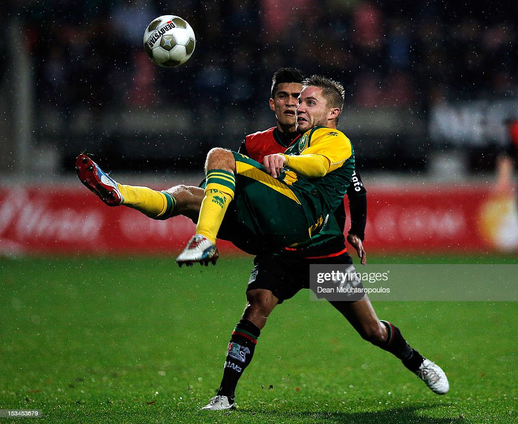 Navarone Foor of NEC defends against Aaron Meijers of Den Haag during the Eredivisie match between NEC Nijmegen and ADO Den Haag at Goffertstadion on...