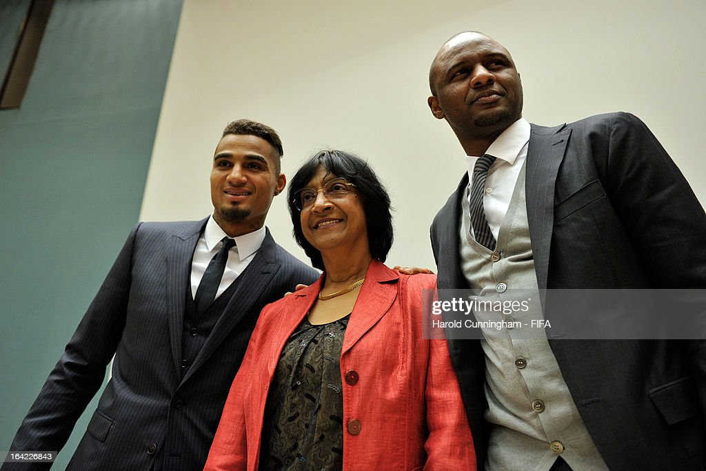 Navi Pillay (C), UN High Commissioner for Human Rights, poses with <a gi-track='captionPersonalityLinkClicked' href=/galleries/search?phrase=Kevin-Prince+Boateng&family=editorial&specificpeople=613049 ng-click='$event.stopPropagation()'>Kevin-Prince Boateng</a> (L) of AC Milan and Ghana and <a gi-track='captionPersonalityLinkClicked' href=/galleries/search?phrase=Patrick+Vieira&family=editorial&specificpeople=202125 ng-click='$event.stopPropagation()'>Patrick Vieira</a> (R), Football Development Executive at Manchester City Football Club, prior to the discussion panel on the International Day for the Elimination of Racial Discrimination at United Nations Office in Geneva on March 21, 2013 in Geneva, Switzerland. On the United Nations' (UN) International Day for the Elimination of Racial Discrimination, the Office of the High Commissioner for Human Rights (OHCHR) see today as a unique opportunity to celebrate diversity and urged all sportswomen and sportsmen, sports authorities and fans to take decisive action against intolerance and racism in sports and celebrate human achievement and excellence beyond the narrow boundaries of ethnicity, race or nationality.