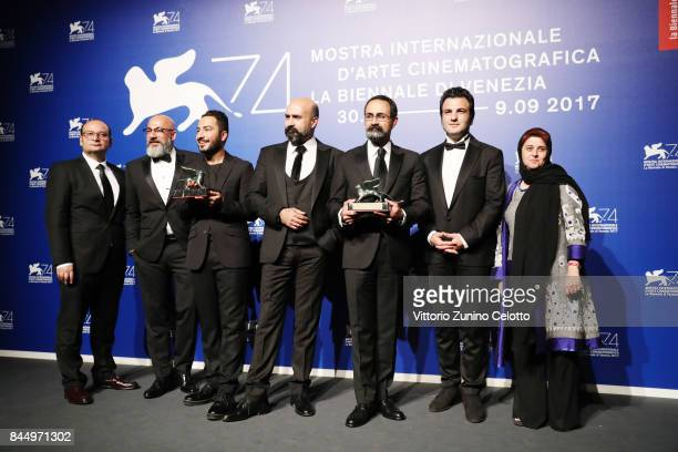 Navid Mohammadzadeh Amir Aghaei Vahid Jalilvand and guests pose with the Orizzonti Award for Best Director and Orizzonti Award for Best Actor for...