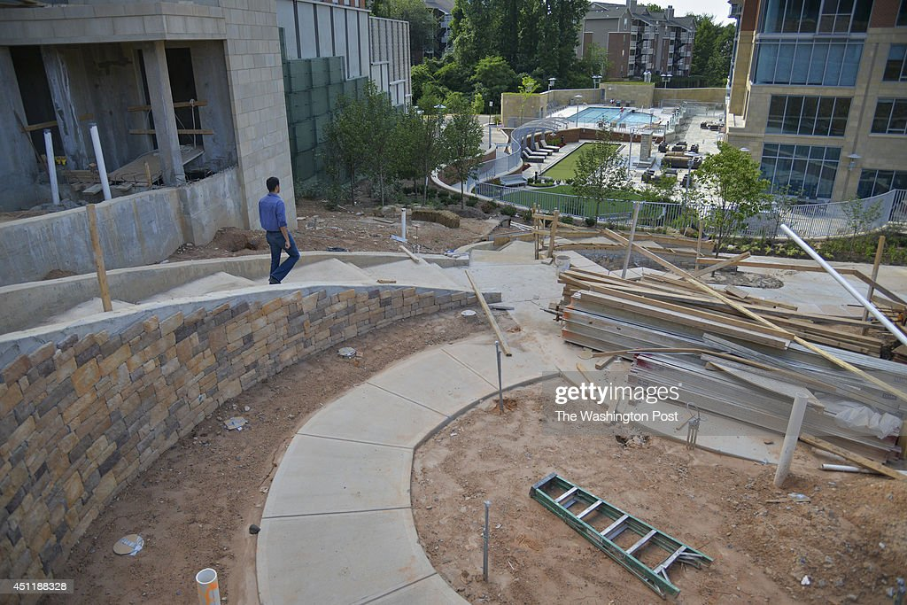 Navid RoshanAfshar says that this new urban park and walkway being built in his Tysons Corner neighborhood is 'just like everything else in Tysons...