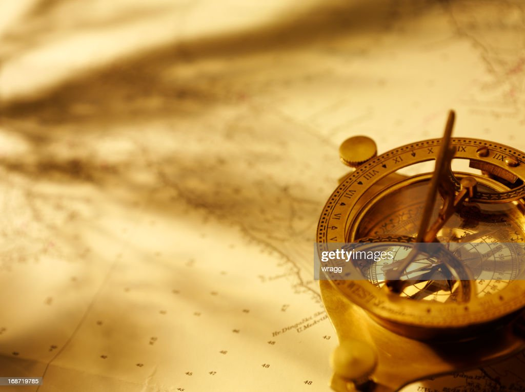Navigation with a Brass Compass : Stock Photo