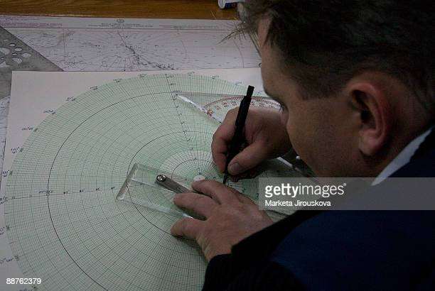 Navigator charting first voyage to 90 degrees North, 0 degrees latitude, icebreaker Yamal, Arctic Ocean