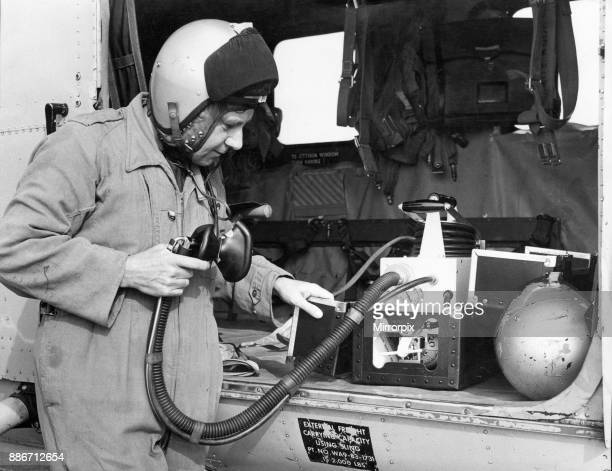 Navigator Steve Cawthorne of 202 Search and Rescue Squadron checks over the oxygen which automatically adjusts its supply to meet the needs of the...
