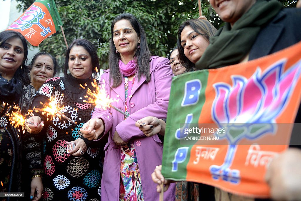 Navjot Kaur Sidhu (2L) Indian Member of the Legislative Assembly (MLA) and wife of Former Indian cricketer and member of parliament Navjot Singh Sidhu, along with members of Bharatiya Janata Party (BJP) play with sparklers as they celebrate the assembly election results in Amritsar on December 20, 2012. Gujarat chief minster Narendra Modi is heading for a landslide election win in Gujarat on , firming up his chances of being nominated by the BJP for running for prime minister in 2014.
