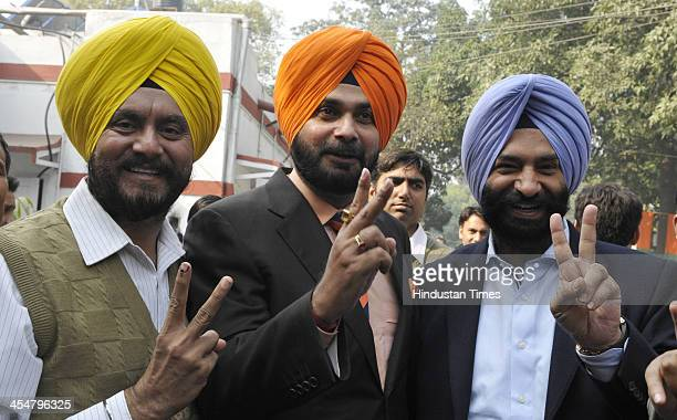 Navjot Singh Sidhu with newly elected BJP MLAs Majinder Singh Sirsa and Jitender Singh Shanty at the meeting of newly elected BJP MLAs at Delhi BJP...