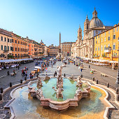 Piazza Navona,Rome,Italy. On the foreground the so called Fontana del Nettuno (Neptune Fountain)