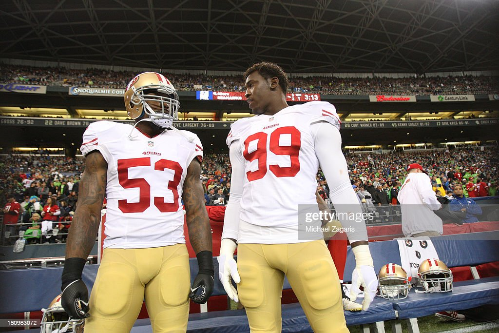 NaVorro Bowman #53 and Aldon Smith #99 of the San Francisco 49ers stand on the sideline during the game against the Seattle Seahawks at CenturyLink Field on September 15, 2013 in Seattle, Washington. The Seahawks defeated the 49ers 29-3.