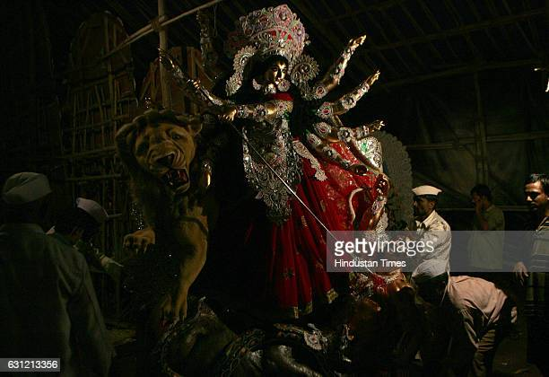 Navratri 2009 Durga Puja Durga idol being taken out from the work shop for Durga pooja festival which will start from tomorrow