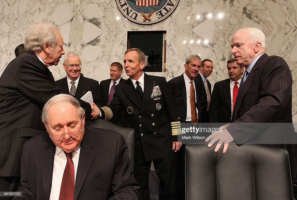 US Navy Adm. Eric Olson (C), commander of the U.S. Special Operations Command greets Sen. Joe Lieberman (I-CT) (L) while Sen. <a gi-track='captionPersonalityLinkClicked' href=/galleries/search?phrase=John+McCain&family=editorial&specificpeople=125177 ng-click='$event.stopPropagation()'>John McCain</a> (R-AZ)(R) and Sen. <a gi-track='captionPersonalityLinkClicked' href=/galleries/search?phrase=Carl+Levin&family=editorial&specificpeople=208878 ng-click='$event.stopPropagation()'>Carl Levin</a> (D-MI) stand nearby before the start of a Senate Armed Services Committee hearing on Capitol Hill on March 16, 2010 in Washington, DC. The committee is hearing testimony on the defense authorization request for fiscal year 2011. Despite tough fighting and periodic setbacks in the war in Afghanistan Petraeus said he expects the United States can reduce its forces as planned, from about 97,000 to 50,000 by the end of August.