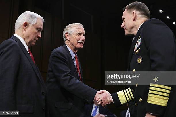Navy Adm Michael Rogers commander of the US Cyber Command director of the National Security Agency and chief of Central Security Services talks with...