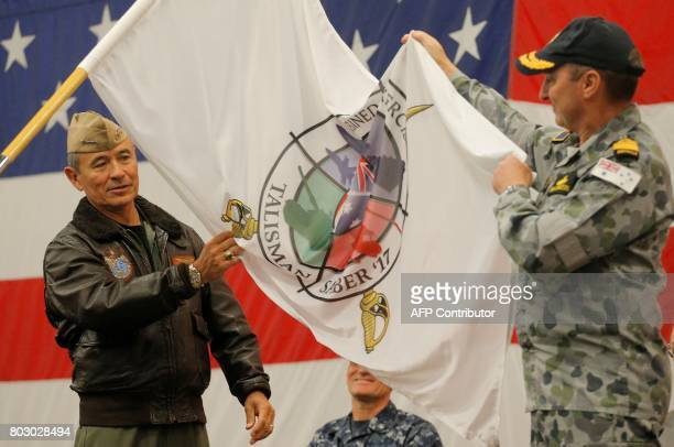 US Navy Admiral Harry Harris Commander of the US Pacific Command and Australian Navy Vice Admiral David Johnston unfurl the Talisman Saber 2017 flag...