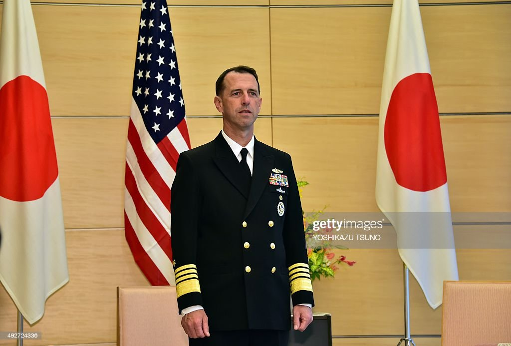 US Navy admiral John Richardson Chief of Naval Operations waits for Japanese Prime Minister Shinzo Abe for their talks at Abe's office in Tokyo on...