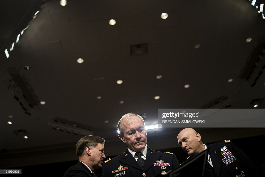Navy Admiral Mark E. Ferguson III (L), Vice Chief of Naval Operations, Army General Martin E. Dempsey (C), Chairman of the Joint Chiefs of Staff, and Army General Raymond T. Odierno, Chief of Staff of the Army, wait a hearing of the Senate Armed Services Committee on Capitol Hill February 12, 2013 in Washington, DC. The committee called Ashton B. Carter, Deputy Secretary of Defense, Robert F. Hale, Under Secretary of Defense and Comptroller, and the Joint Chiefs of Staff to testify about the effects of the impending spending cuts knows as sequestration which will go into effect on March 1. AFP PHOTO/Brendan SMIALOWSKI