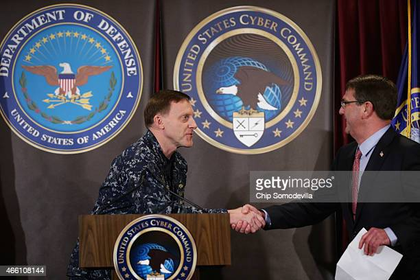 Navy Admiral Michael Rogers commander of the US Cyber Command and director of the National Security Agency welcomes Secretary of Defense Ash Carter...