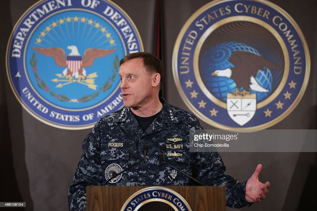 Navy Admiral Michael Rogers commander of the US Cyber Command and director of the National Security Agency delivers remarks before introducing...