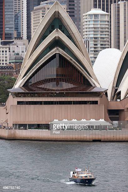 A navy barge with Prince Charles Prince of Wales sails past the Sydney Opera House on his way to a Sustainability Leadership Roundtable at Admiralty...