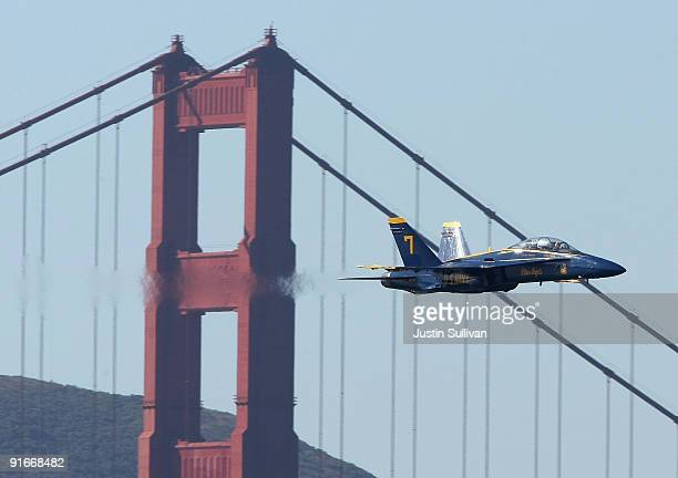 S Navy Blue Angels F/A18 Hornet passes in front of the Golden Gate Bridge during a practice performance ahead of the Fleet Week air show October 9...
