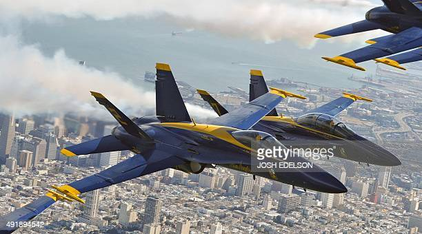 US Navy Blue Angels F/A18 Hornets fly in a practice run for Fleet Week over San Francisco California on October 8 2015 Fleet Week started on October...