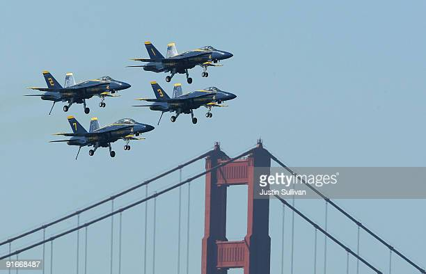 S Navy Blue Angels F/A18 Hornets pass over the Golden Gate Bridge during a practice performance ahead of the Fleet Week air show October 9 2009 in...