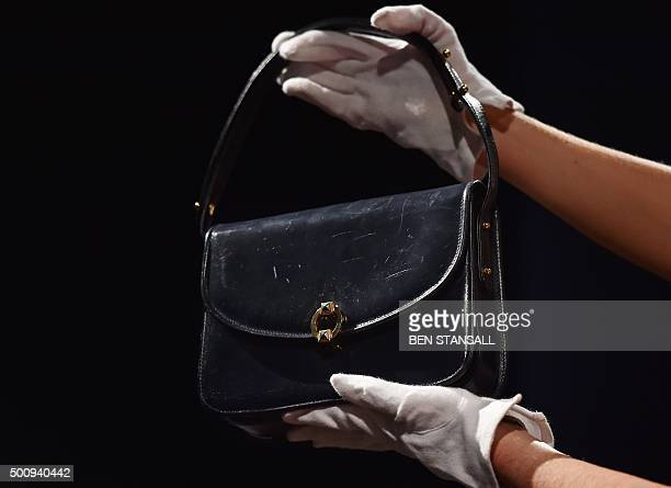 A navy blue leather handbag by Launer London circa 1980's used by former British Prime Minister Margaret Thatcher and expected to realise 2000 3000...