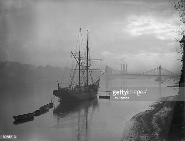 A Navy cadet training ship on the Thames at Battersea London with Albert bridge in the background