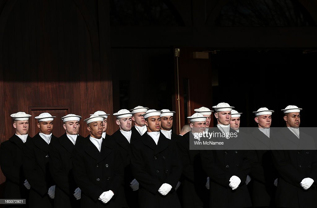 U.S. Navy ceremonial team members await the beginning of a funeral service at Arlington National Cemetery for two unknown sailors who were killed in 1862 when the Civil War era USS Monitor sank off the coast of North Carolina March 8, 2013 in Arlington, Virgiina. The sailors' remains, recovered when a portion of the ship was raised eleven years ago, were buried with full military honors.