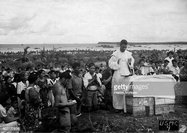 Navy chaplain conducts mass for the indiginious Chamorro people on Guam United States 1944 The service was the first the people had attended since...