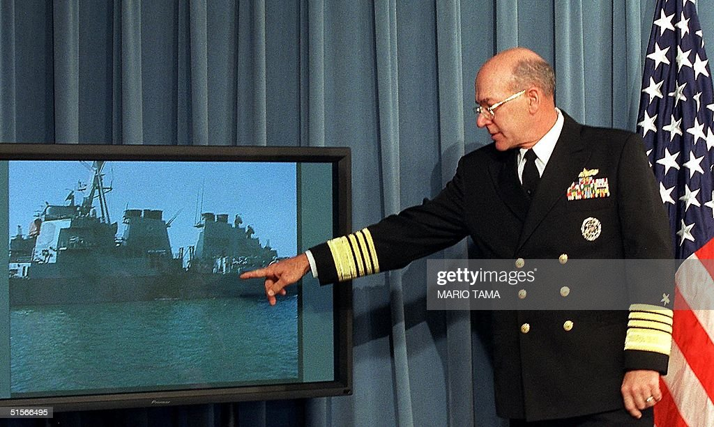 US Navy Chief of Operations Admiral Vern Clark points to a photograph showing a hole in the side of the USS Cole during a briefing at the Pentagon 12 October 2000 in Washington, DC. The USS Cole was attacked by a boat loaded with explosives earlier 12 October 2000 in the Yemeni port of Aden. (FILM) AFP PHOTO/Mario TAMA