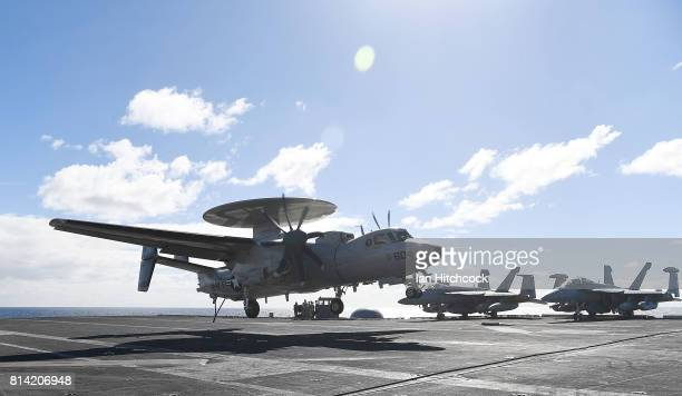 Navy E2 Hawkeye lands on the deck of the USS Ronald Reagan on July 14 2017 in Townsville Australia USS Ronald Reagan is a 1092 foot aircraft carrier...