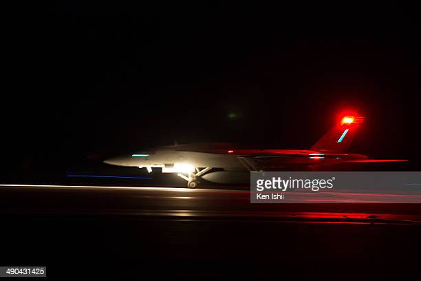 S Navy F/A18 Super Hornet conducts a touch and go landing during the Field Carrier Landing Practice of the Carrier Air Wing 5 of US Naval Air...