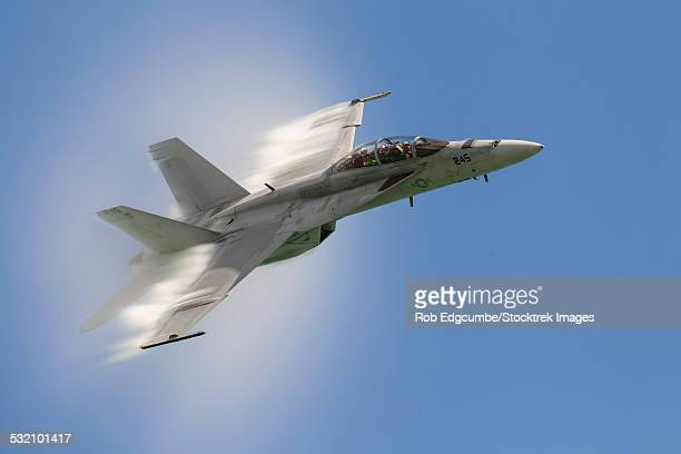 A U.S. Navy F/A-18F performs a fast pass over Chicago, Illinois.