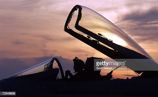 S Navy flight crewman works in the cockpit of a US Navy F/A18 Hornet after returning to base aboard the USS Constellation January 15 2003 which is...