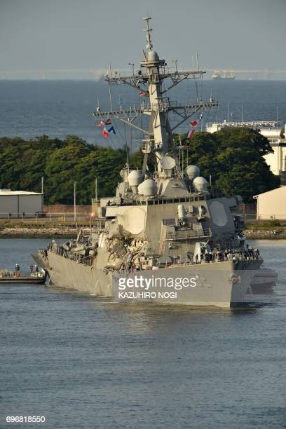 US Navy guided missile destroyer USS Fitzgerald arrves at its mother port US Naval Yokosuka Base Kanagawa prefecture on June 17 2017 The US and Japan...