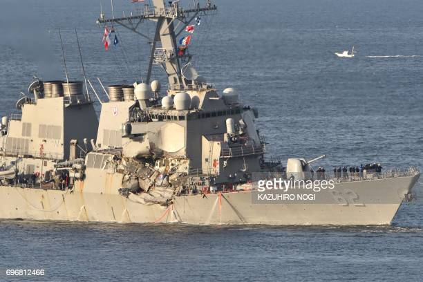 US Navy guided missile destroyer USS Fitzgerald sails into its mother port US Naval Yokosuka Base Kanagawa prefecture on June 17 2017 The US and...