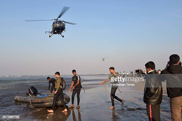 A navy helicopter and coast gaurd teams conducting search operation to locate the body of a college student who drowned along with 13 of his...